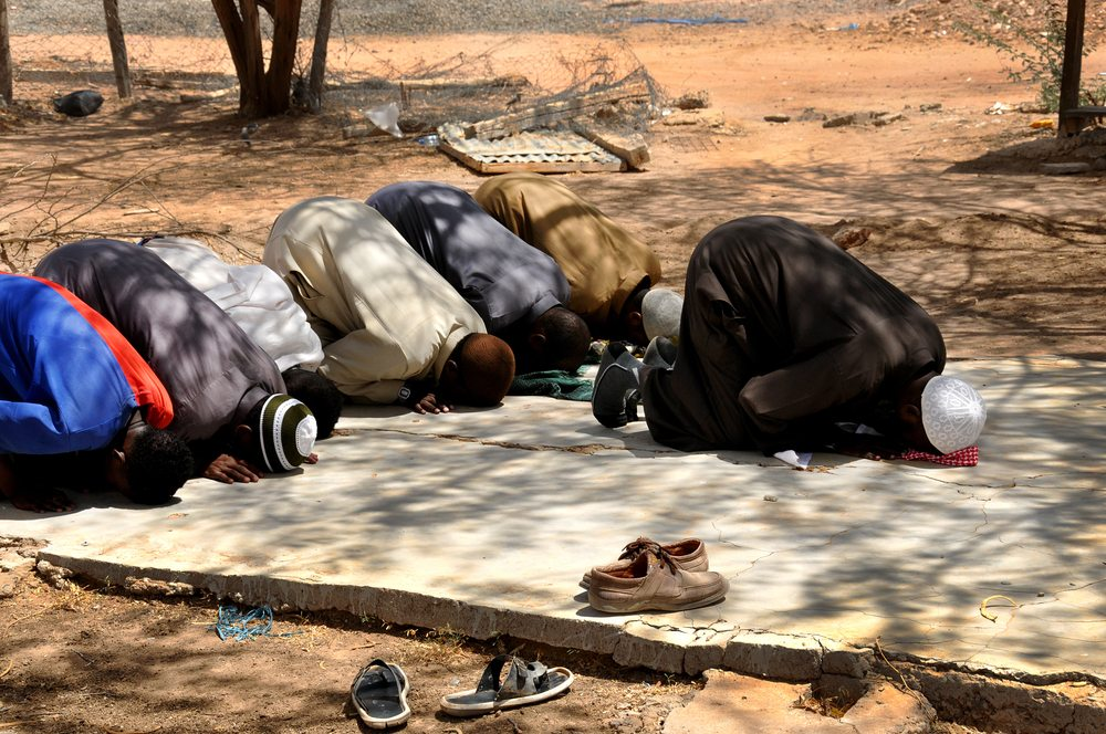 Isis want you to pray just like this... No not like that.   You in the blue, off with your head!